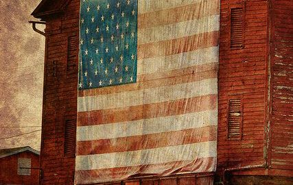 flag + red barn